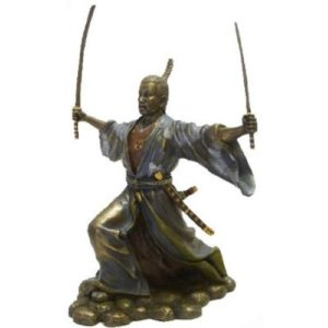 Photo of Samurai with Two Swords Attacking Figurine
