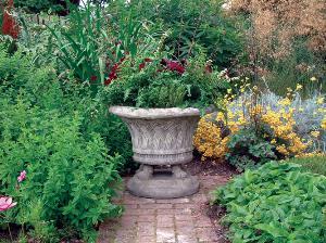 Photo of Plaited Stone Vase with Feet