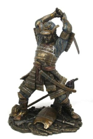 Photo of Samurai Attacking Bronze Figurine Sword Above Head