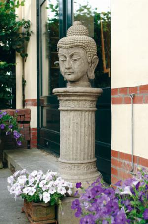 Photo of Stone Buddha Head on Large Doric Column