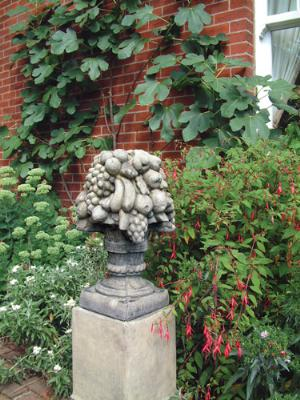 Photo of Basket of Fruit Stone Finial