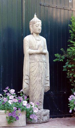 Photo of Standing Buddha Stone Statue