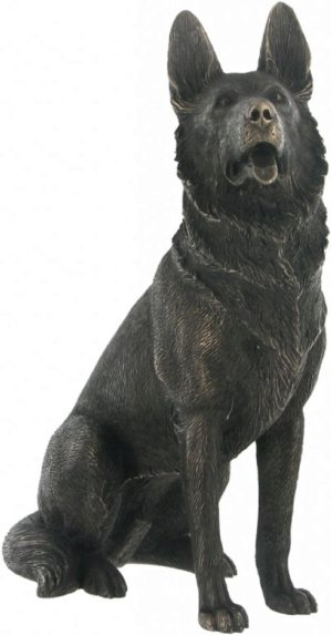Photo of German Shepherd Dog Sitting Bronze Dog Sculpture