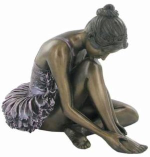 Photo of Ballerina Preparing Bronze Figurine