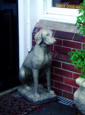 Photo of Dog Stone Garden Sculpture