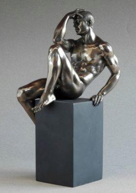 Photo of Nude Male Bronze Figurine on Plinth