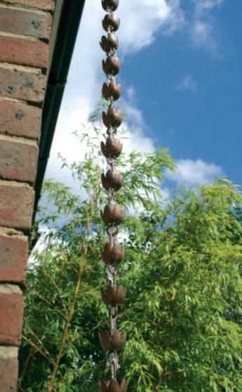 Photo of Rain Chain Copper Lily Down Pipe Ornament