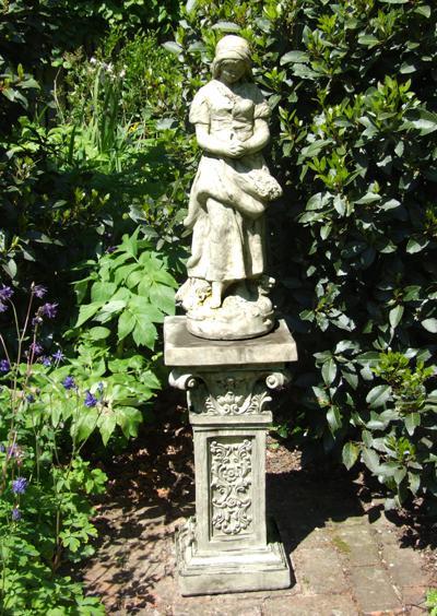 Photo of Peasant Girl Stone Statue