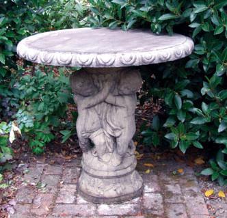 Photo of Three Cherub Stone Table