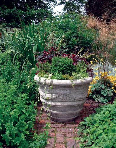 Photo of Large Draped Stone Vase with Feet