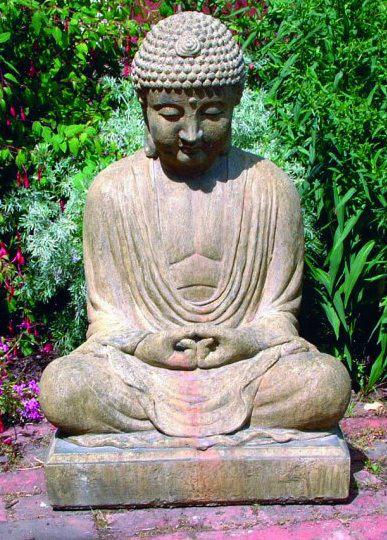 Photo of Meditating Buddha Stone Statue