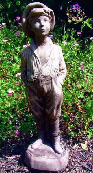 Photo of Whistling Urchin Boy Stone Statue