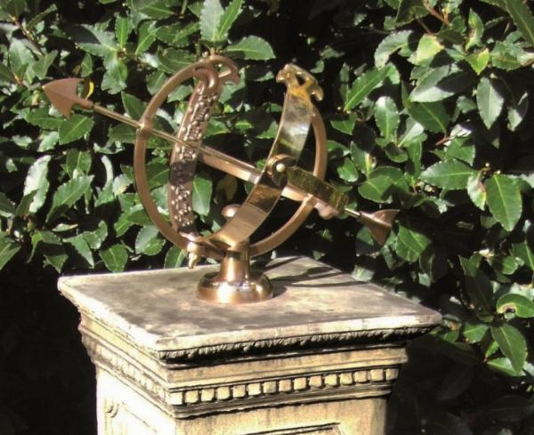 Photo of Floral Stone Plinth with Brass Armillary