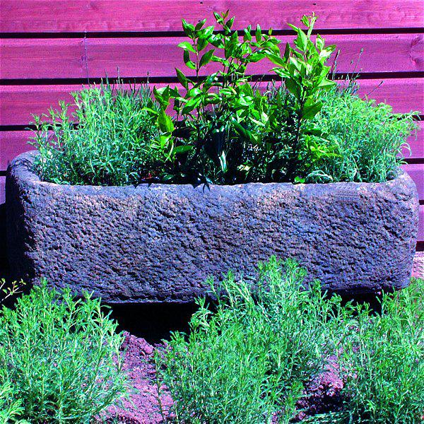 Photo of Rustic Stone Trough with Feet