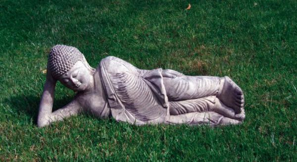 Photo of Relaxing Buddha Stone Statue