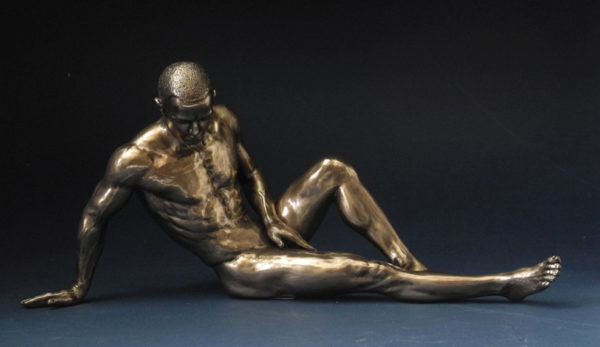 Photo of Resting Nude Male Alone Bronze Figurine