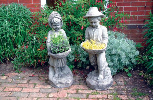 Photo of Swain Boy and Swain Girl Stone Statues