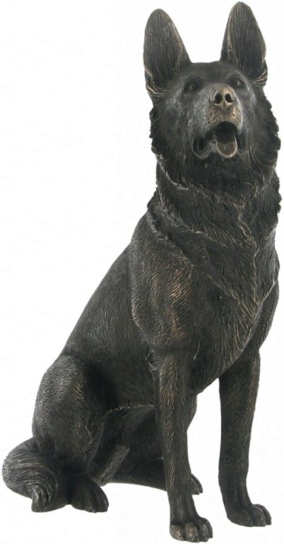 Photo of German Shepherd Dog Sitting Bronze Dog Sculpture