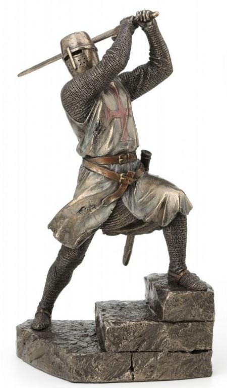 Photo of Knight with Sword Attacking Bronze Figurine