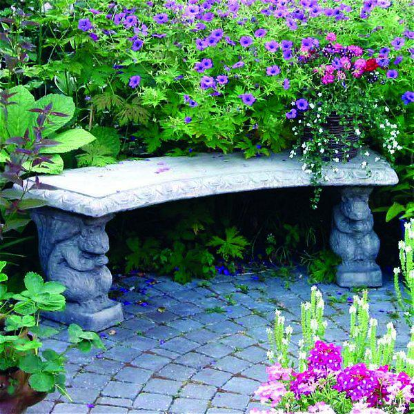 Photo of Curved Patterned Top Squirrel Stone Bench