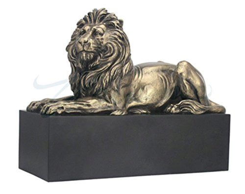 Photo of Lion Bronze Figurine on Black Plinth