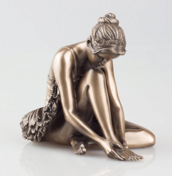 Photo of Ballerina Preparing Bronze Figurine
