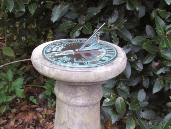 Photo of Small Stone Column with Aged Brass Sundial