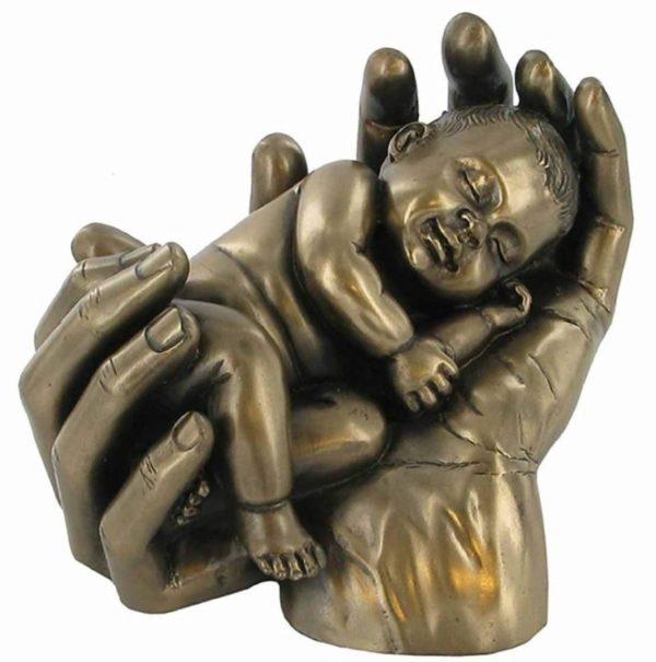 Photo of Baby in Hands Bronze Figurine Sweet Dreams
